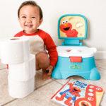 Kid squatting besides his Elmo Potty